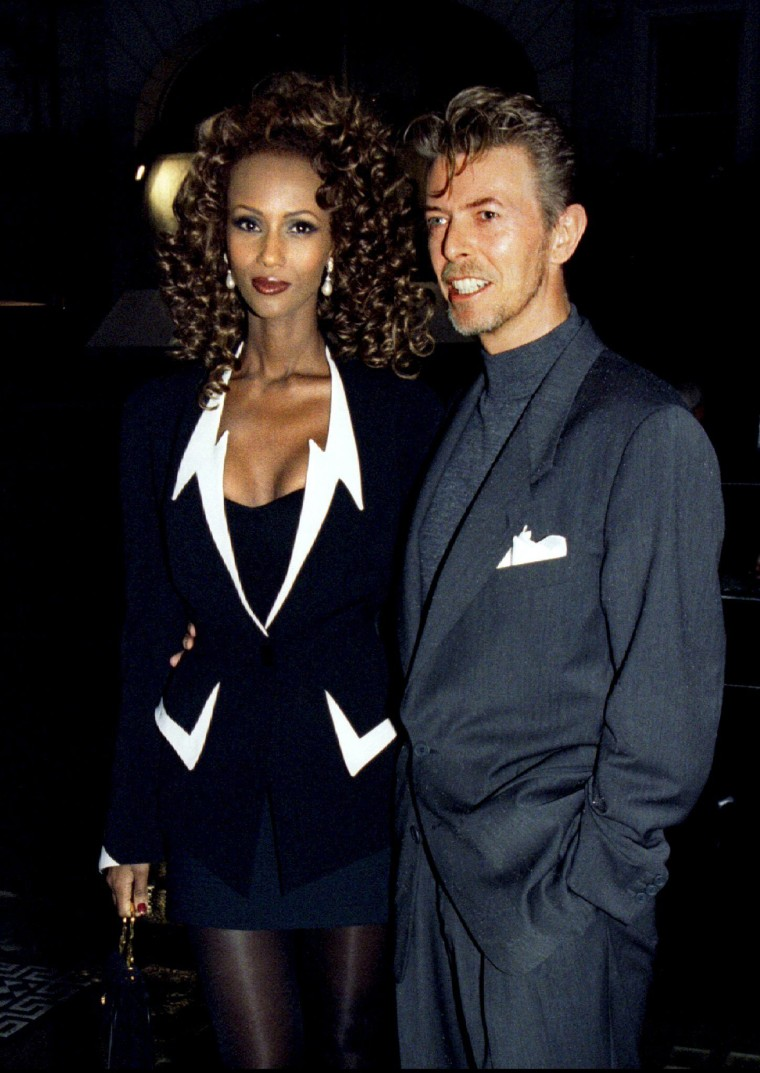 Image: File photo of David Bowie and his wife Iman arriving for the launching of a new art magazine at the Fine Art Society's Mayfair gallery in London