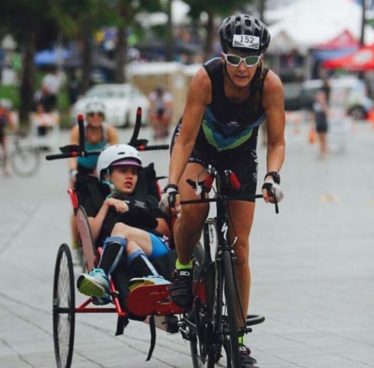 The mother-daughter duo competing in the 2015 Challenged Athletes Foundation Triathlon.
