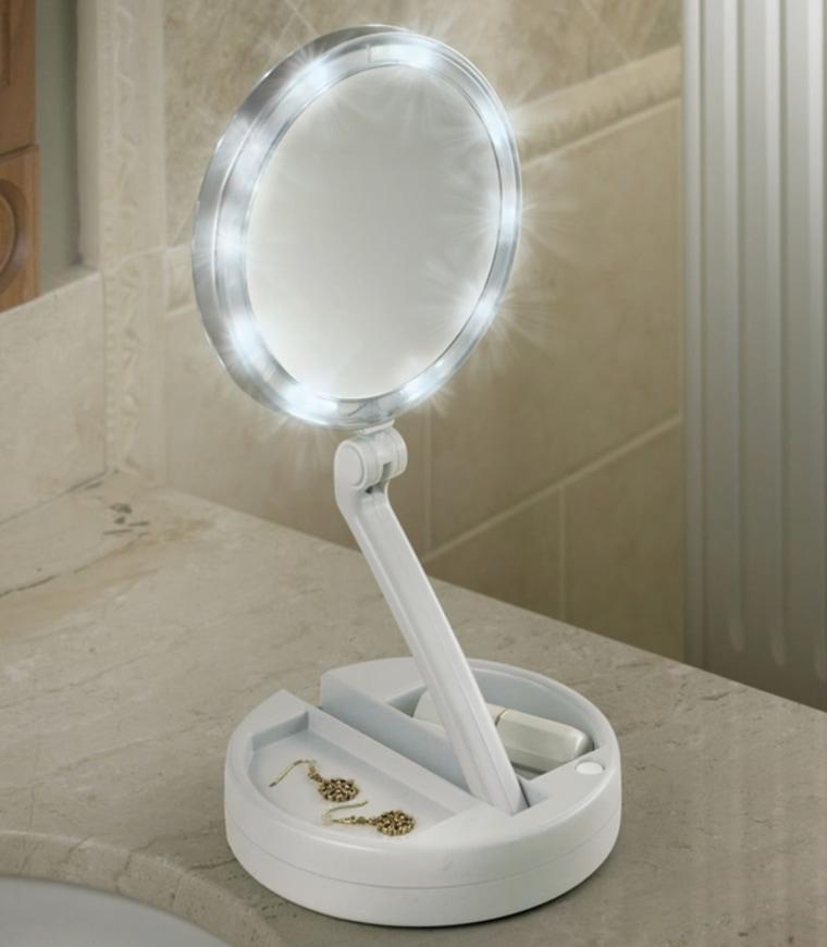 The Brighter Foldaway Vanity Mirror, $79.95, Hammacher Schlemmer