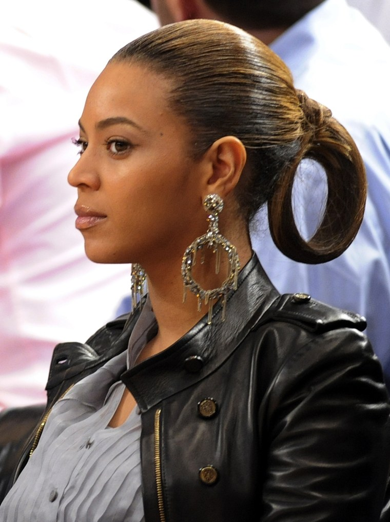 Image: Beyonce watches New York Knicks play Cleveland Cavaliers in their NBA basketball game in New York