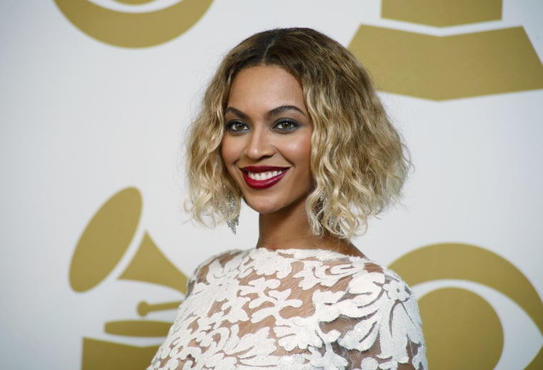 Image: Beyonce poses backstage after performing at the 56th annual Grammy Awards in Los Angeles