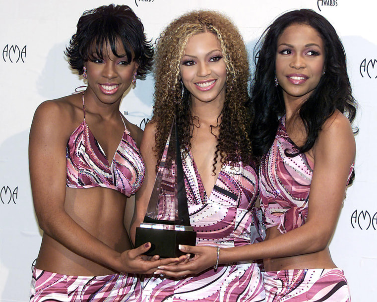 (L to R) Kelly Rowland, Beyonce Knowles, and Miche