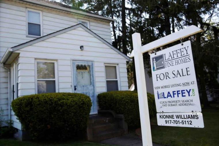 A 'for sale' is seen outside a single family house in Garden City, New York