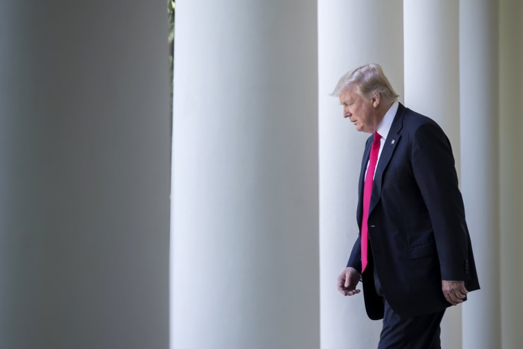 Image: Trump walks from the Oval Office to the Rose Garden