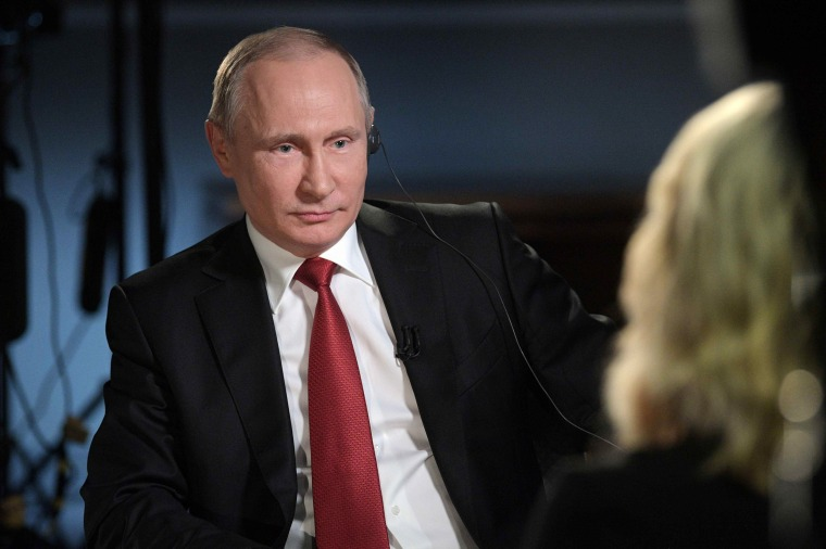 Image: Putin speaks with Kelly during an interview