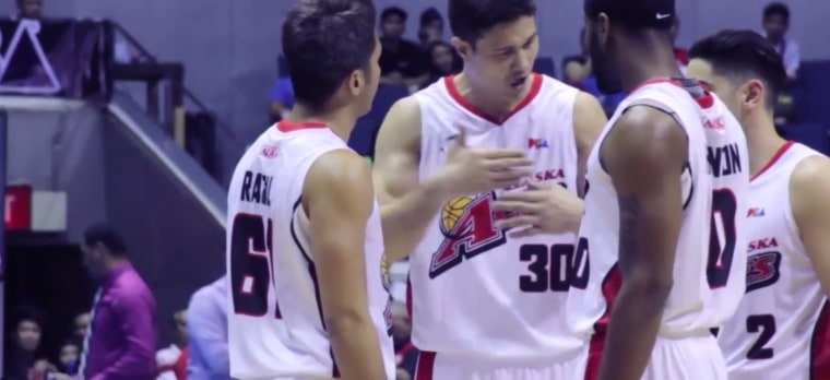 Eric Menk (center), moved to the Philippines to play professional basketball in 1997. Before retiring earlier this year, he had won multiple championships and MVP awards.