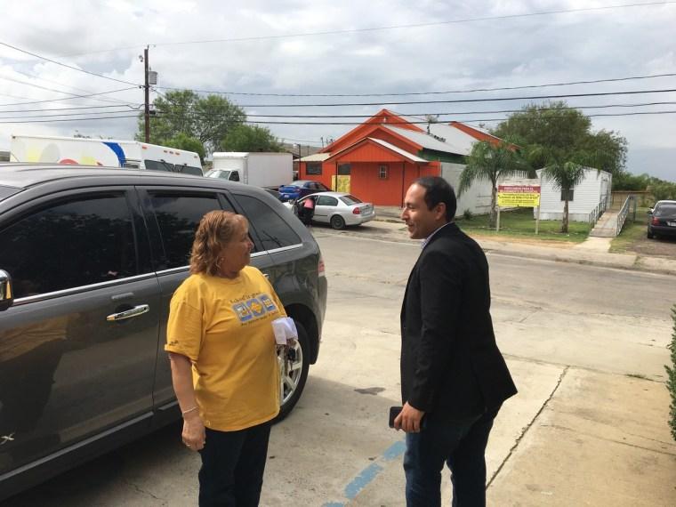 Mayor Reyes visits with a city resident El Cenizo, Texas.