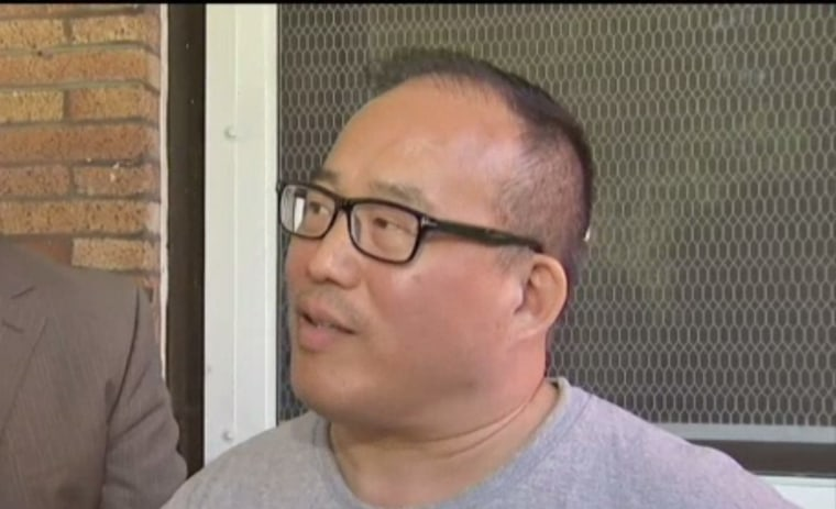 Councilman David Oh at an impromptu press conference on his porch after returning home from the hospital.