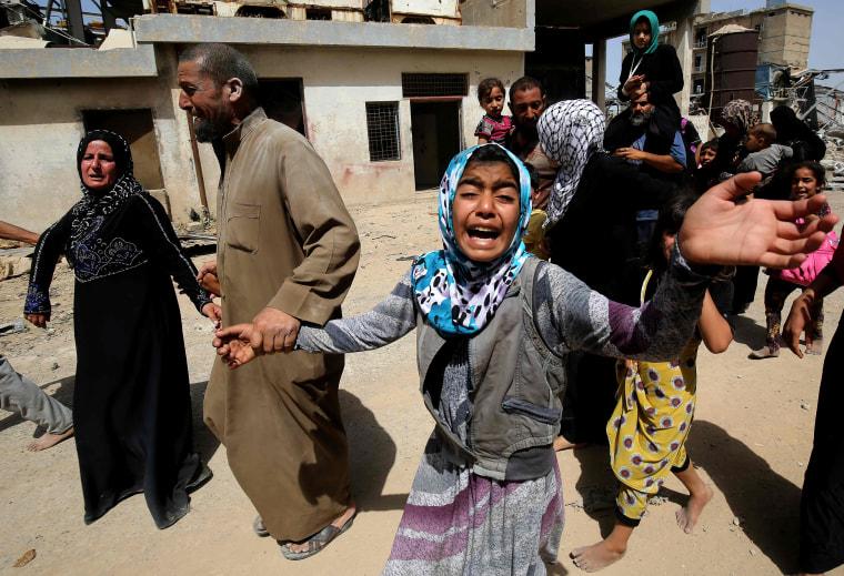 Image: An Iraqi girl cries as displaced Iraqis from western Mosul's al-Islah al-Zaraye neighbourhood flee the area