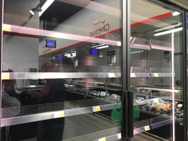 Image: Empty shelves in a supermarket in Doha, Qatar