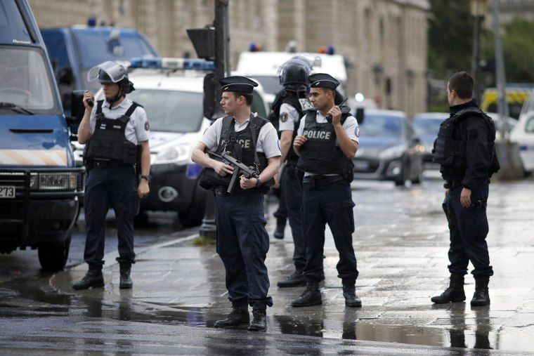 Image: Police officers seal off the access to Notre Dame cathedral in Paris