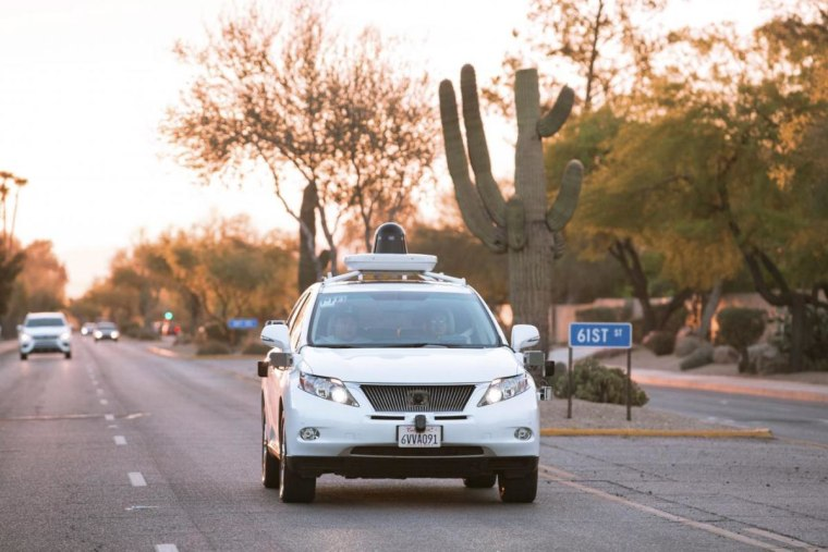 Test drivers use a Lexus SUV, built as a self-driving car, to map the area prior to a journey without a driver in control, in Phoenix