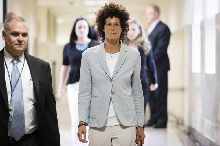 Image: Andrea Constand walks to the courtroom during Bill Cosby's sexual assault trial