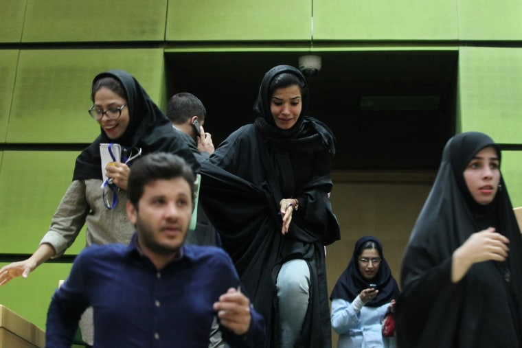 Image: Women are seen inside the parliament during an attack in central Tehran