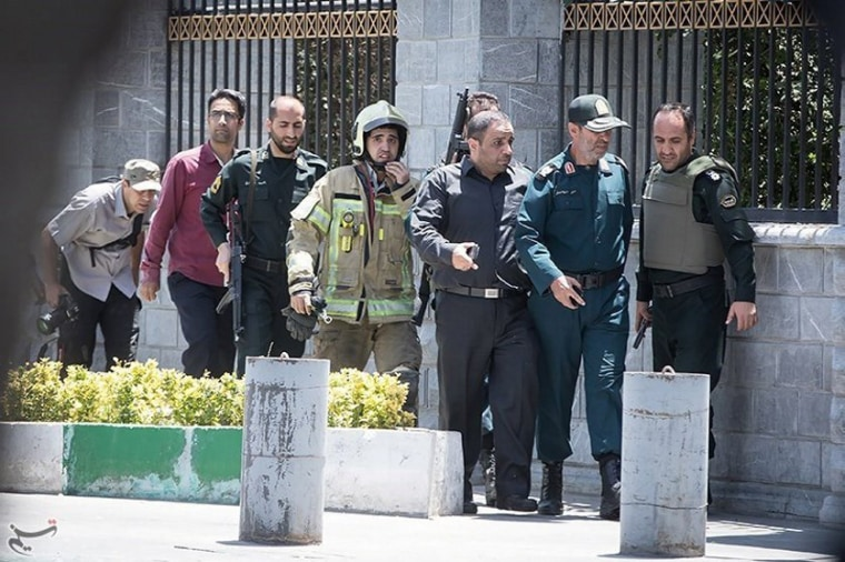 Image: Members of Iranian forces are seen during an attack on the Iranian parliament in central Tehran