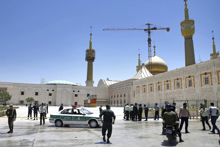 Image: Police officers control the scene outside the shrine of late Iranian revolutionary founder Ayatollah Khomeini