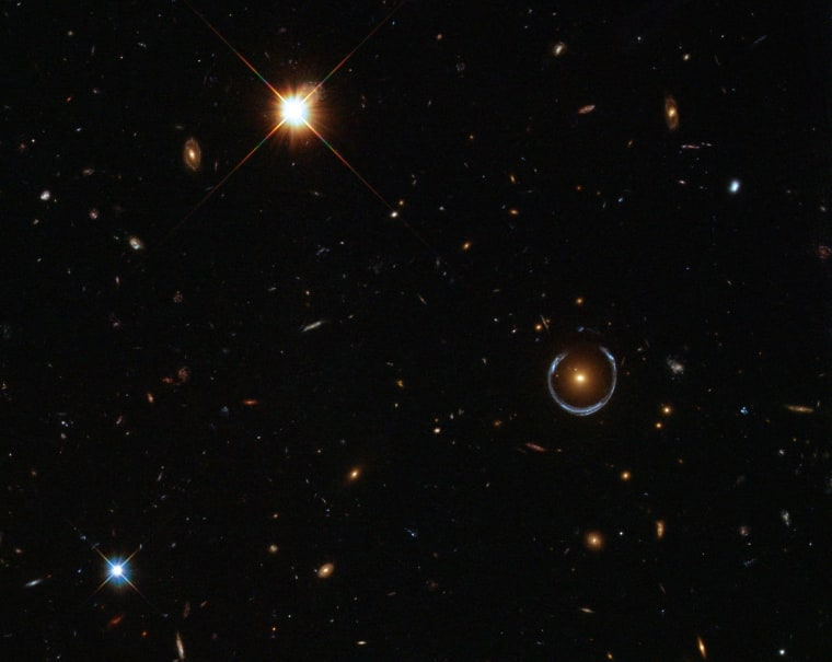 This image shows an Einstein ring (middle right), which occurs when a massive object acts like a lens for light coming toward the observer from a background object. This phenomenon is known as gravitational lensing, and recently used for the first time to measure the mass of an individual star.