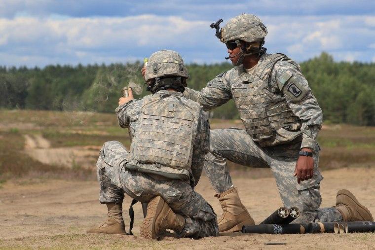Image: Mortar gunners fire mortar rounds