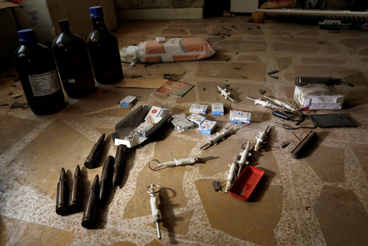Image: Materials for making self-made bombs are seen on the floor inside a compound used as a prison by Islamic State militants