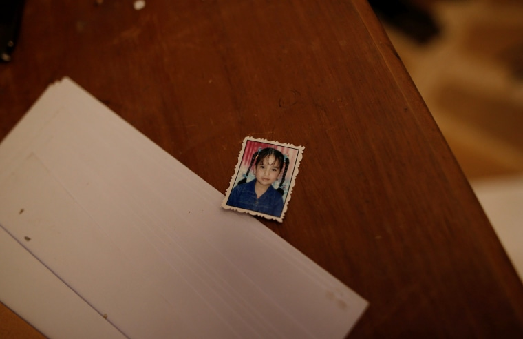 Image: The photo of an unidentified girl is seen on a desk inside a compound used as prison by Islamic State militants