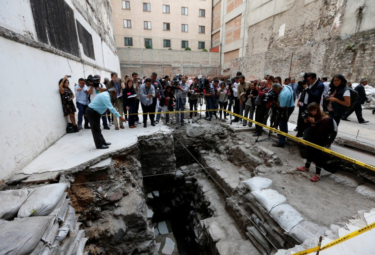 Image: Raul Barrera, an archaeologist from the National Institute of Anthropology and History (INAH) shows to the media a new Aztec discovery a ritual ball court, during a tour of the area, located just off the Zocalo plaza in the heart of downtown Mexico
