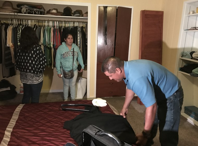 Image: Andres Magana Ortiz hugs packs his suitcase before turning himself into immigration officials