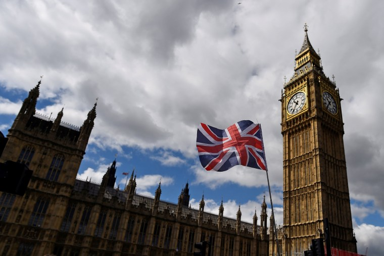 Image: The Union Flag flies near the Houses of Parliament the day before a general election in central London