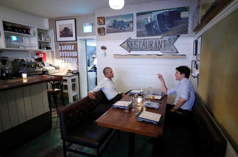 Image: Canada's Prime Minister Justin Trudeau speaks with former United States President Barack Obama at a restaurant in Montreal