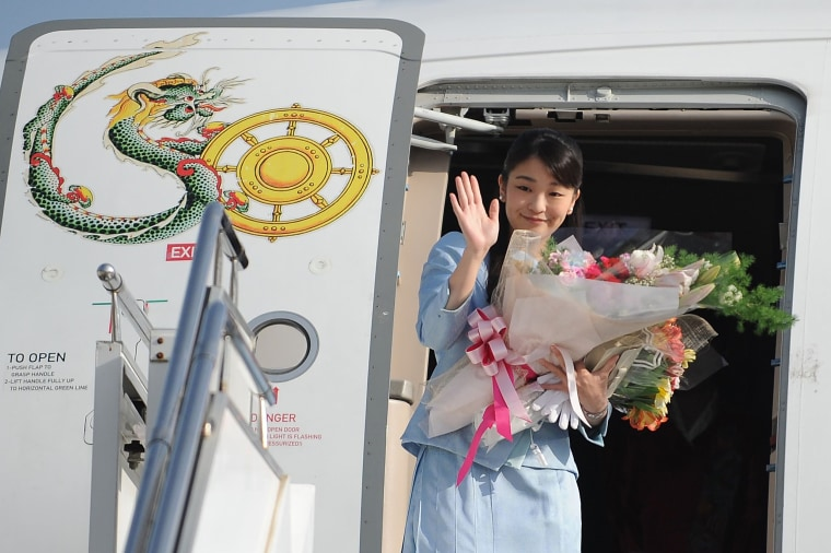 Image: Japan's Princess Mako waves prior to her departure