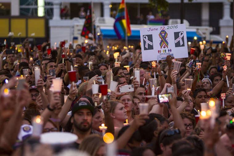 A crowd gathers in Orlando to remember the fallen victims of the Pulse shooting.