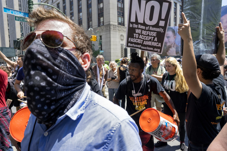 Counter demonstrators yell towards a nearby rally protesting Islamic law Saturday, June 10, 2017, in New York.