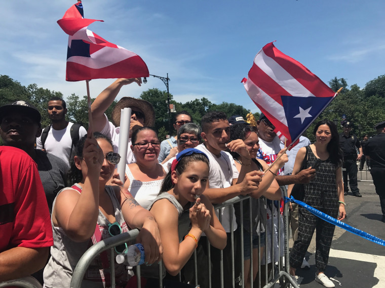 A group of spectators line the streets during the 60th Puerto Rican Day Parade.