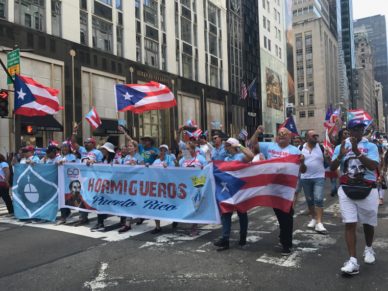 Scenes from the 60th Puerto Rican Day Parade.  A group from the town of Hormigueros, Puerto Rico march past the crowds.