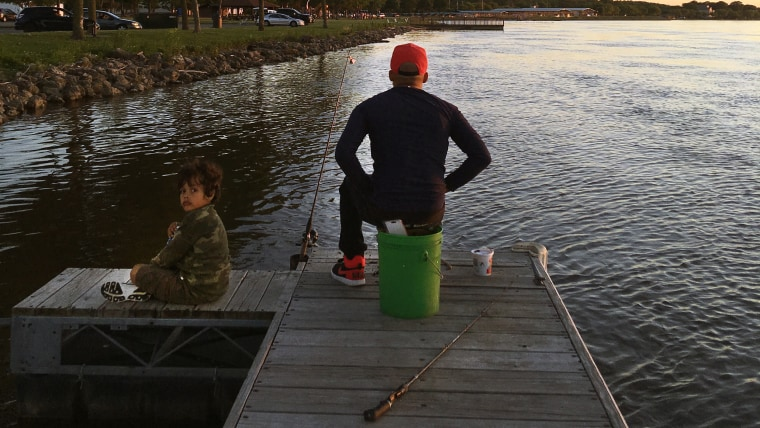 Malik William's last moments fishing with his 6-year-old son Jaden were captured by an amateur photographer last week.