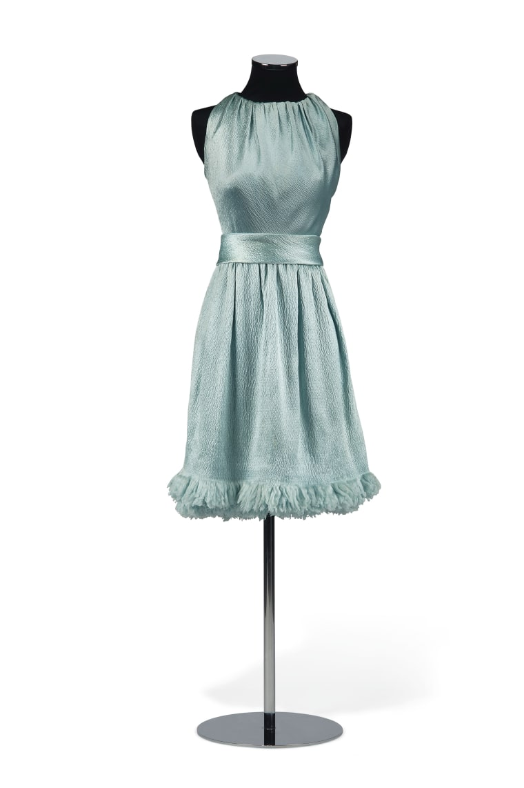 "Hubert de Givenchy designed this cloqué silk cocktail dress for Hepburn for a 1966 photo shoot promoting her film ""Two for the Road."""