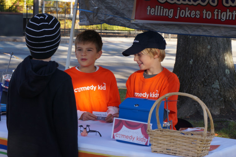 Max and Alex tell a joke during their Comedy Kids fundraiser last November at the Chappaqua Farmer's Market in New York.