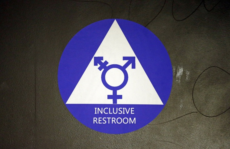 Image: A new sticker designates a gender neutral bathroom at a high school in Seattle.