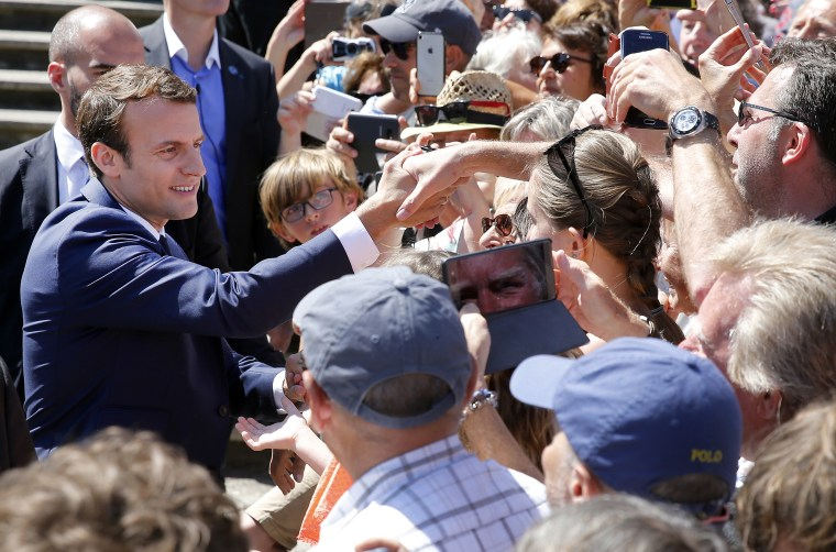Image: French President Emmanuel Macron leaves the polling station of the town hall in Le Touquet-Paris-Plage, after casting his vote