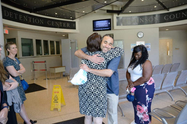 Image: Richard Jones reconnects with family after being released from prison.
