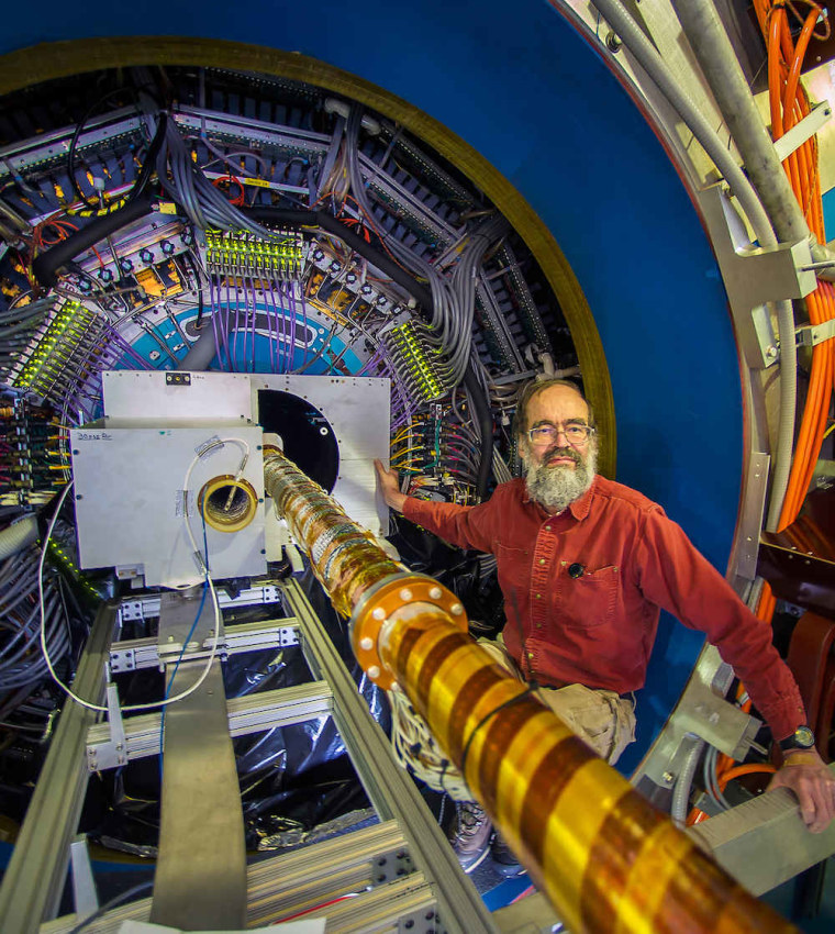 Brookhaven Lab physicist Flemming Videbaek during installation of the Heavy Flavor Tracker at the STAR detector at RHIC, a particle collider at Brookhaven National Laboratory. New insights from the experiment reveal that charm quarks may interact more with the quark-gluon plasma than previously thought.