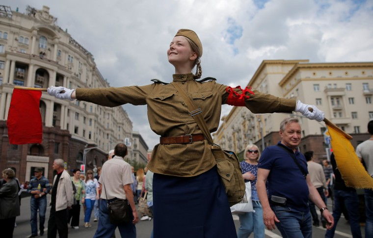 Image: A performer dressed in a historical uniform takes part in a re-enactment festival which coincides with an anti-corruption protest organised by opposition leader Alexei Navalny, on Tverskaya Street in central Moscow