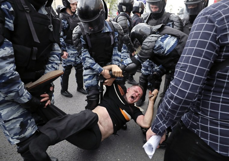 Image: Russian police officers detain a participant of an unauthorized opposition rally