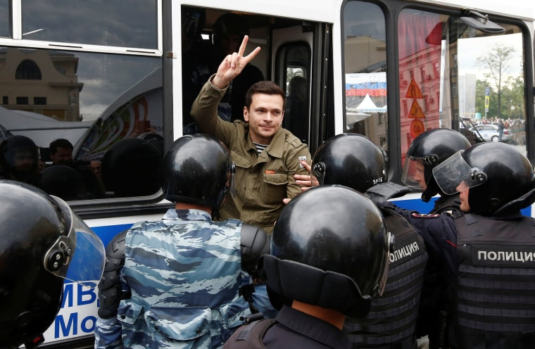 Image: Riot police detain Russian opposition figure Ilya Yashin during an anti-corruption protest organised by opposition leader Alexei Navalny, in central Moscow