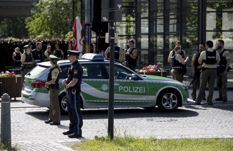 Image: Police guard in front of a subway station in Munich, Germany