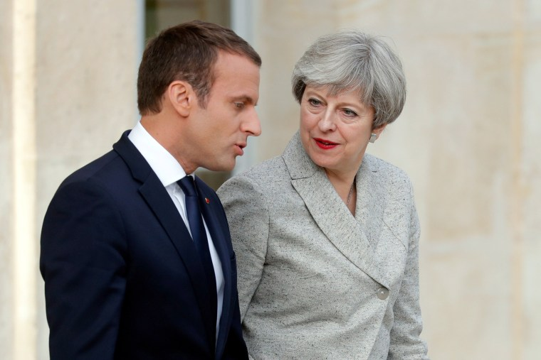 Image: French President Emmanuel Macron escorts Britain's Prime Minister Theresa May as they arrive to speak to the press at the Elysee Palace in Paris