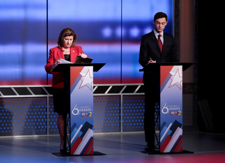 Image: Republican candidate Karen Handel and Democratic candidate Jon Ossoff prepare for Georgia's 6th Congressional District special election debate at WSB-TV studios in Atlanta