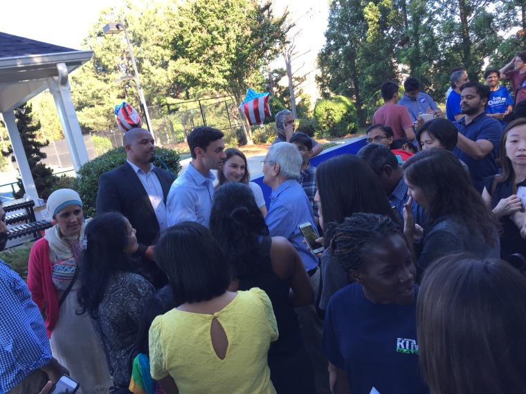 Jon Ossoff meets with Asian-American voters at a community event.