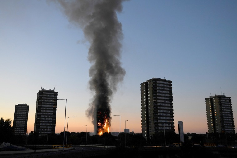 Image: Flames and smoke billow as firefighters deal with a serious fire in a tower block at Latimer Road in West London