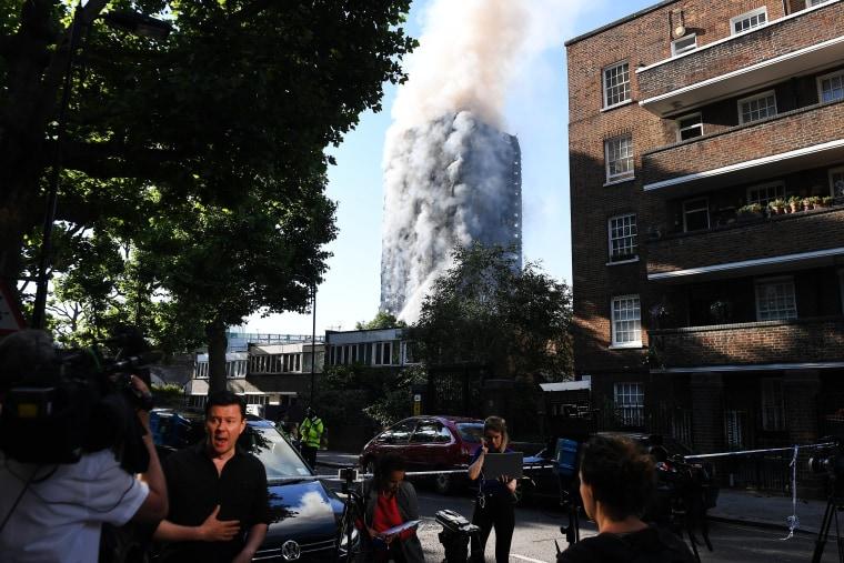 Image: Media outside a huge tower block fire in West London
