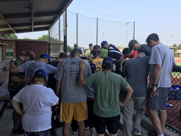 Members of the House Democrats baseball team pray for their Republican colleagues after the shooting.
